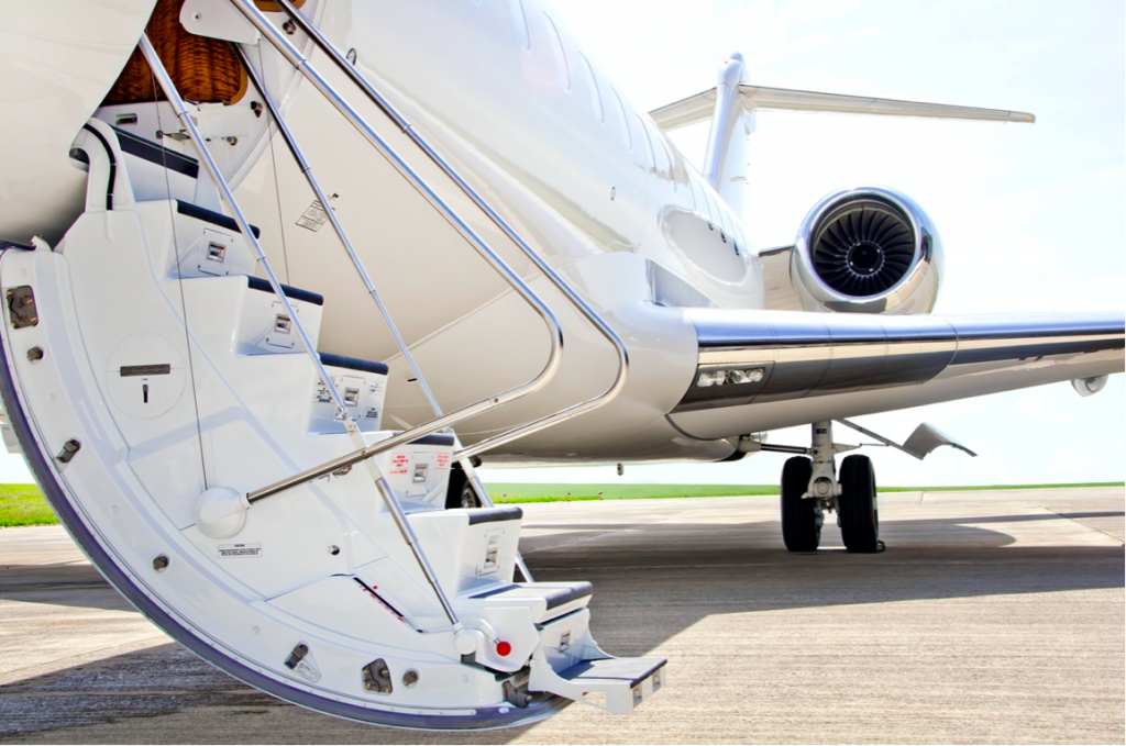 set of stairs extending from a white private jet